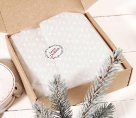Weißes Seidenpapier als Geschenk