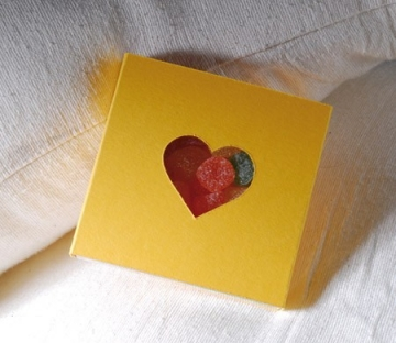 Box with a die-cut heart on it