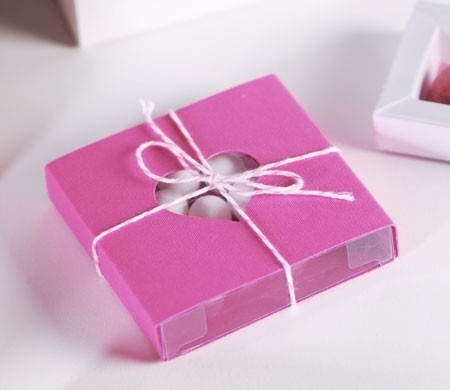Romantic pink gift box with a cut-out heart