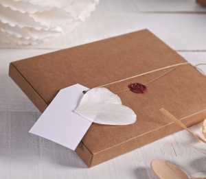 Little box decorated with wax seal and feathers