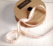 White grosgrain ribbon with maroon backstitches