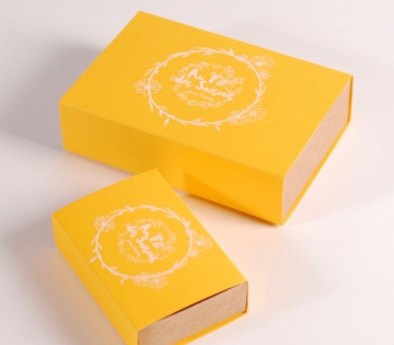 Yellow matchbox-sized gift box