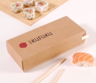 Cardboard box for sushi with a stick compartment